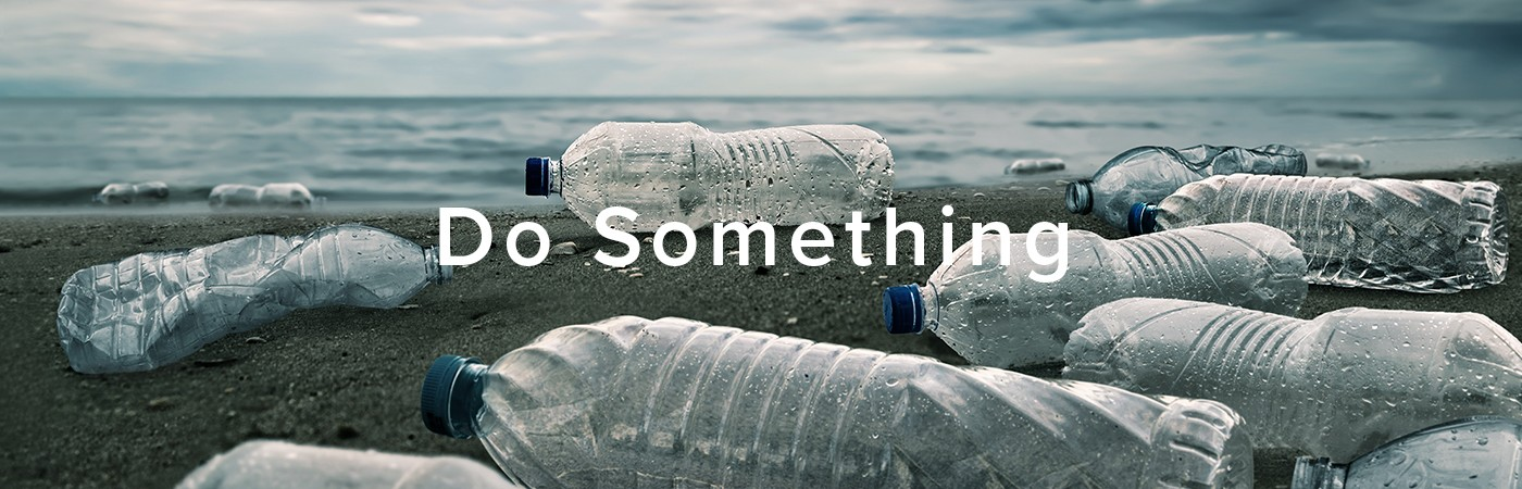 "A photograph of a beach littered with plastic bottles, covered with the words ""Do Something."" Photo credit: chaiyapruek2520"