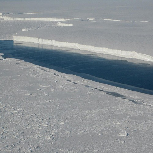 A large river of melt water runs through the Venable Ice Shelf in West Antartica. Photo courtesy NASA/JPL-Caltech/UC Irvine